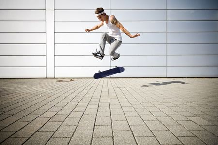 skater making a flip with his skateboard photo