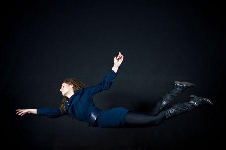 levitating: beautiful woman flying in studio Stock Photo