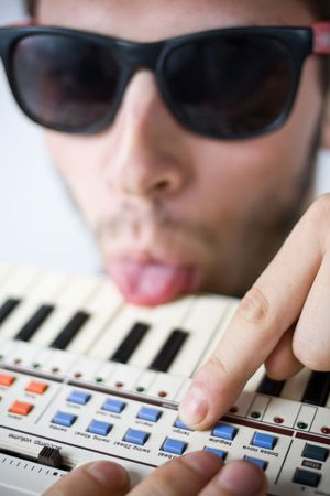 sound bite: cool guy frustrated with his tiny keyboard Stock Photo