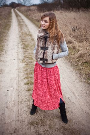 woman on rural road in late autumn Stock Photo - 5670698