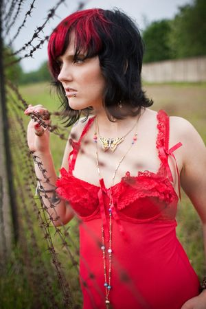 caught woman behind barb wire fence Stock Photo - 5924763