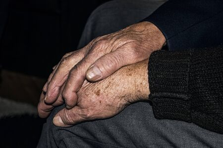 80 plus adult: Senior husband touching the hand of his old wife.