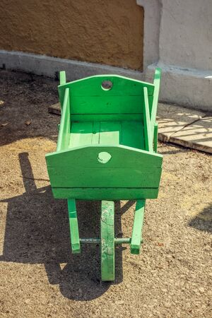 pushcart: Close-up of old wooden decorative handmade green pushcart.
