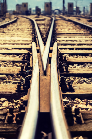 diminishing perspective: Close-up at ground level of a railroad track junction. Vaninshing point and diminishing perspective in the middle of the tracks.