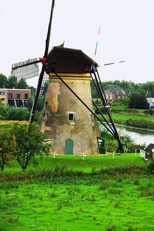 Windmill in Kinderdijk in Holland Stock Photo