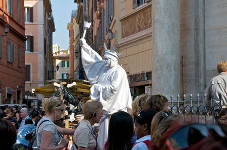 live work city: Rome. Italy. Living statue.