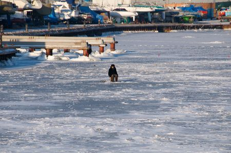 Fishermen on the ice in winter