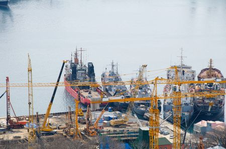 to ensure: Vladivostok. Cranes against a background of ships to ensure