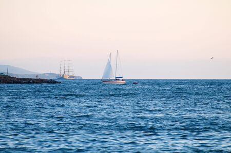 enters: Sailing yacht enters the bay Editorial
