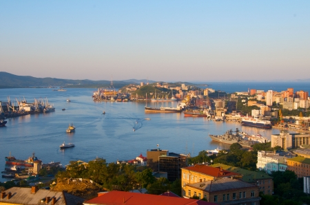 rising sun: Port of Vladivostok. Golden Horn bay in the rays of the rising sun.