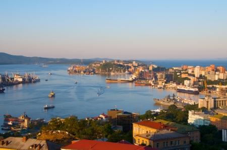 Port of Vladivostok. Golden Horn bay in the rays of the rising sun.