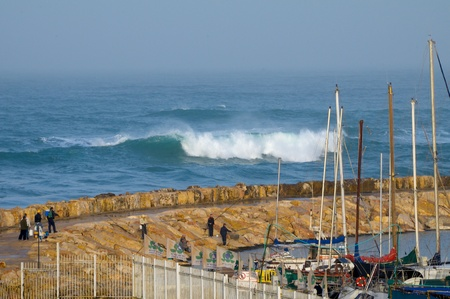 Big waves. Storm. Fishermen in the Mediterranean Sea in the winter.