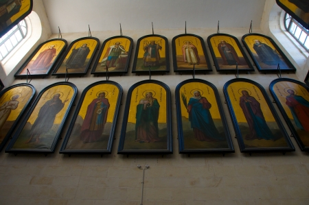 heroism: Church of Alexander Nevsky. Icons in black frames and canvases devoted to suffering and heroism of Jesus Christ