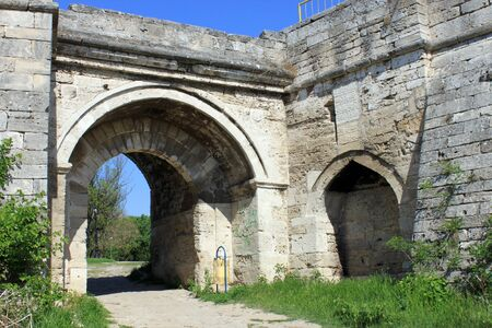 fortified wall: An old fortified wall with arc and entrance. Medieval fortress Baba Vida entrance and wall in Vidin, northwestern Bulgaria. The fortress is one of the biggest landmarks in the region.