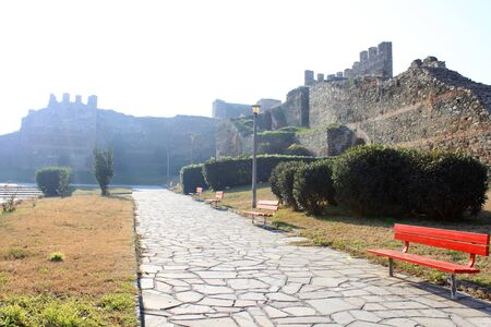 fortified wall: Paved pathway with red benches and lanterns along the fortified wall in Thessaloniki, Northern Greece