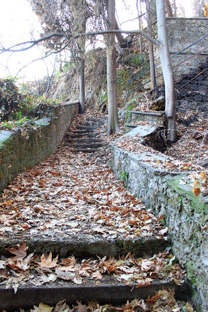 stoned: Old stoned stairs full of autumn leaves in the park. Photo taken in Edessa, Greece.