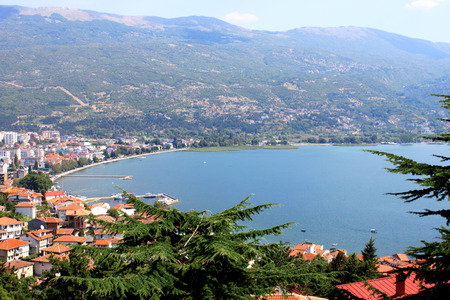 macedonian: Aerial view of Ohrid Lake, city of Ohrid and mountains in the background. Ohrid is a Macedonian resort and famous tourist destination under the auspices of UNESCO