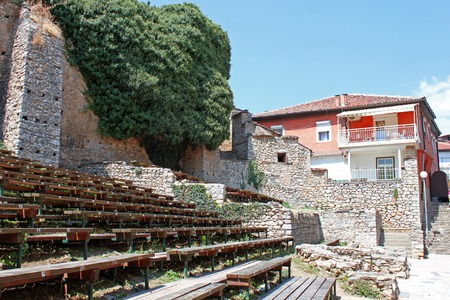 stoned: Amphitheatre seats, old stoned walls with plants and traditional Macedonian house in the centre of Ohrid, Republic of Macedonia