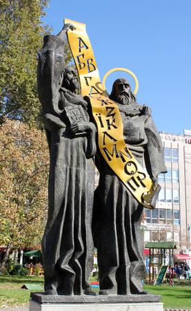 cyrillic: PAZARDZHIK, BULGARIA - CIRCA OCTOBER 2013 - Monument of Saints Cyril and Methodius holding Cyrillic alphabet. Editorial