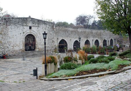 arcs: Inside of a Medieval Serbian Fortress in Nis, Serbia. Stone walls, arcs and pavements.