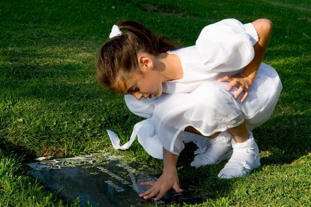 gravesite: Girl in a white dress with a gravesite