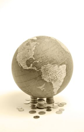 Globe over white background either with or without money Banco de Imagens