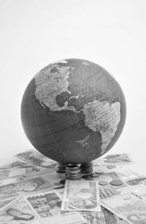 either: Globe over white background either with or without money Stock Photo