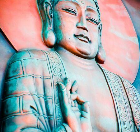 A wall mural of a Buddha in an Buddhist temple photo