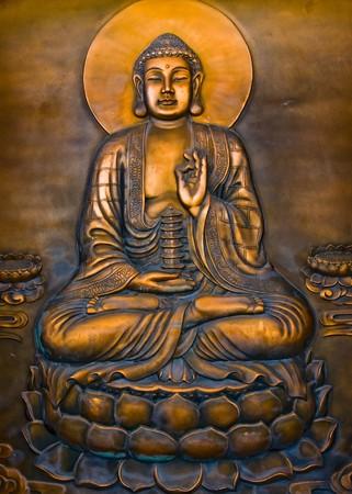 A Buddha sitting on lotus and holding a pagoda photo