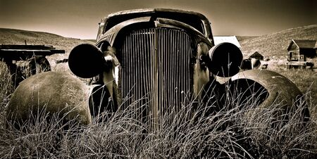 Objects in various stages of decay and aging, abandoned and forgotten - vintage Chevy. Stock Photo