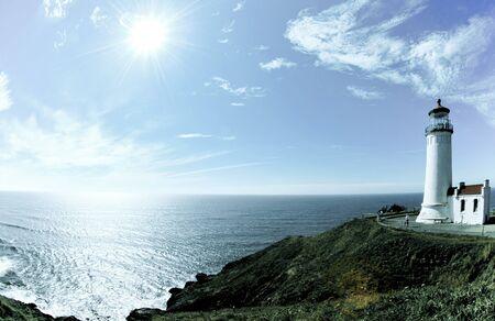 Lighthouse on a hillside overlooking the ocean