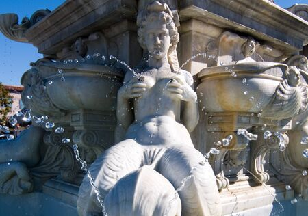 cherubs: Fountain of Poseidon with trident along with nymphs and cherubs and water