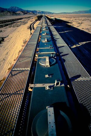 Retired wagons in the desert outside Trona Pinnacles, California Фото со стока