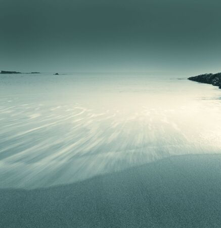Ebb tide in late afternoon, blue