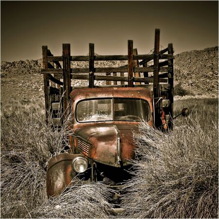 An abandoned truck located in the desert of Eastern Sierra, California photo