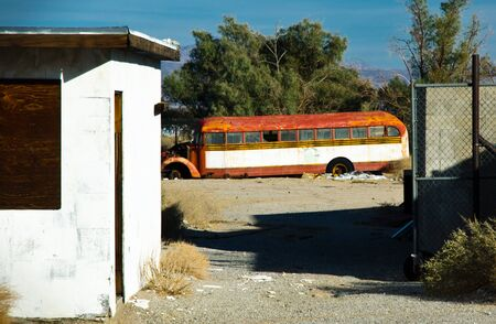 Photograph of a vintage yellow school bus now turned rusty with age. Stock Photo - 11505495