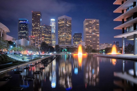 The skyline of Los Angeles after dark, with fountains. Stock Photo