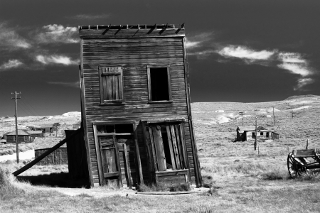 west usa: Old building propped up by a wooden post in an old west ghost town. Stock Photo