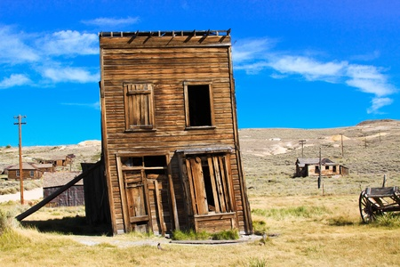 western usa: Old building propped up by a wooden post in an old west ghost town. Stock Photo