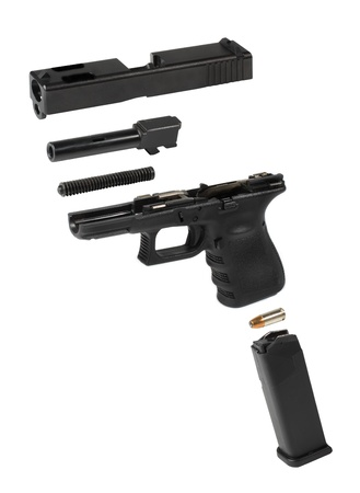 Exploded view of an automatic pistol over a white background. photo