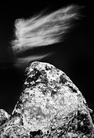 One of the many rocks in the Alabama Hills of California, this one with a cloud. Stock Photo - 11506038