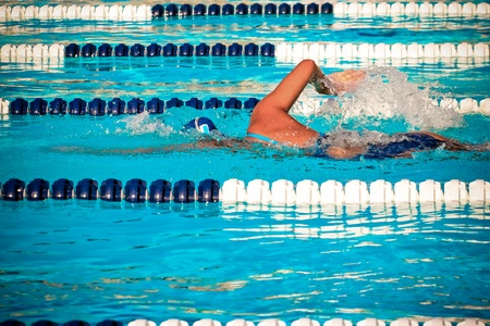 Photograph of a swimmer during a race.