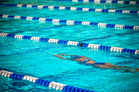 Photograph of a swimmer during a race. photo