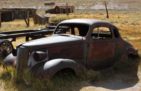 1937 Chevy without wheels abandoned in the desert.