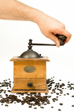 hand crank: Vintage coffee grinder mill and beans photographed over a white background. Stock Photo