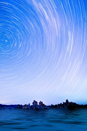 One hour sections of light and star trails over Mono Lake tufas. photo