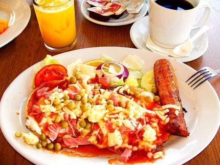 traditional Mayan breakfast dish, Huevos Motulenos. photo