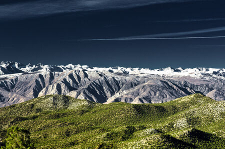 sierras: The grand Eastern Sierras captured with a wind swept sky and full moon.