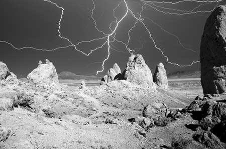 outdoor electricity: The Trona Pinnacles desert area with daytime lightning before a storm.