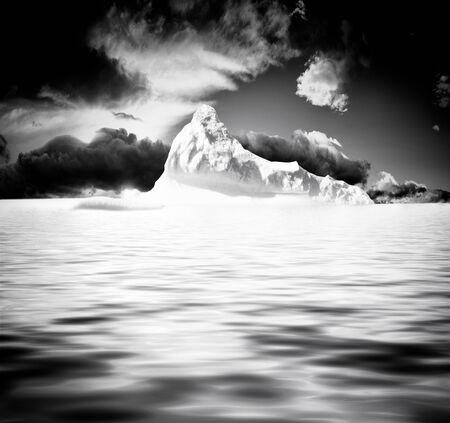 Iceberg floating on the placid surface of the arctic sea.